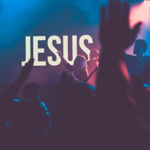 Worship with the name Jesus in background